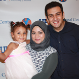 Rasha Elhesha with her husband and daughter