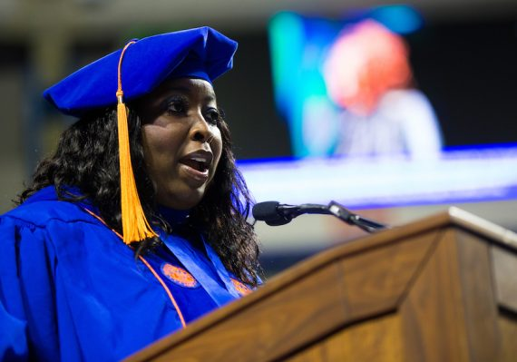 Sanethia Thomas speaks during the college recognition ceremony