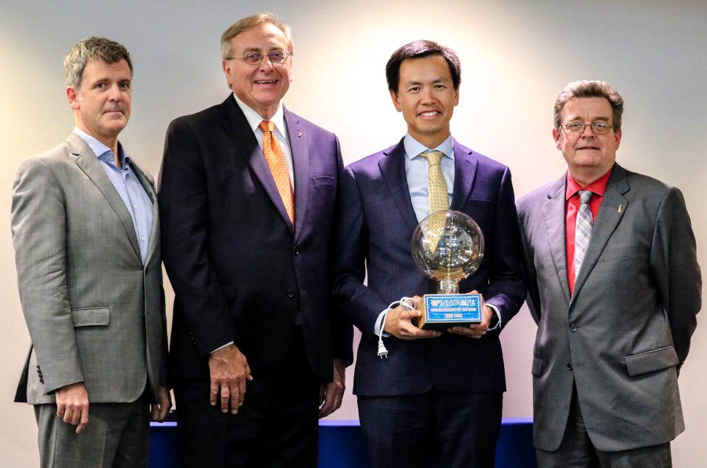 Tech Licensing Director Jim O'Connell, UF President Dr. Kent Fuchs, Dr. Benjamin Lok, and Office of Research Vice President Dr. David Norton.