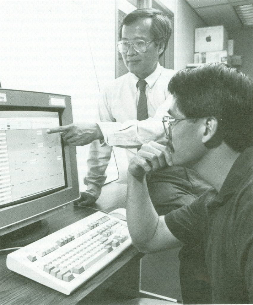Stanley Su, Ph.D., works with Herman Lam, Ph.D.