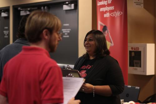 A representative from State Farm interviews a student