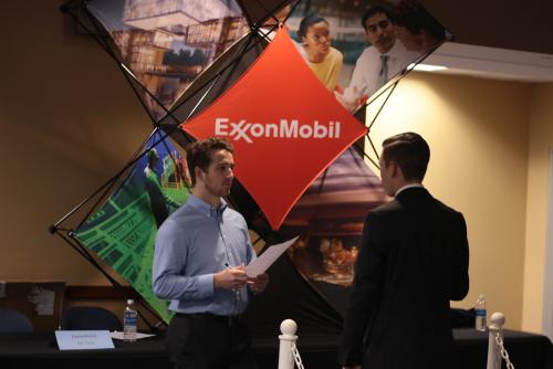 A representative from ExxonMobil interviews a student