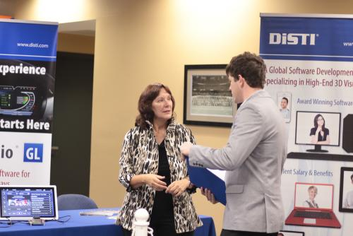 A representative from DiSTI interviews a student