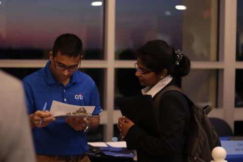 A representative from Citi interviews a student